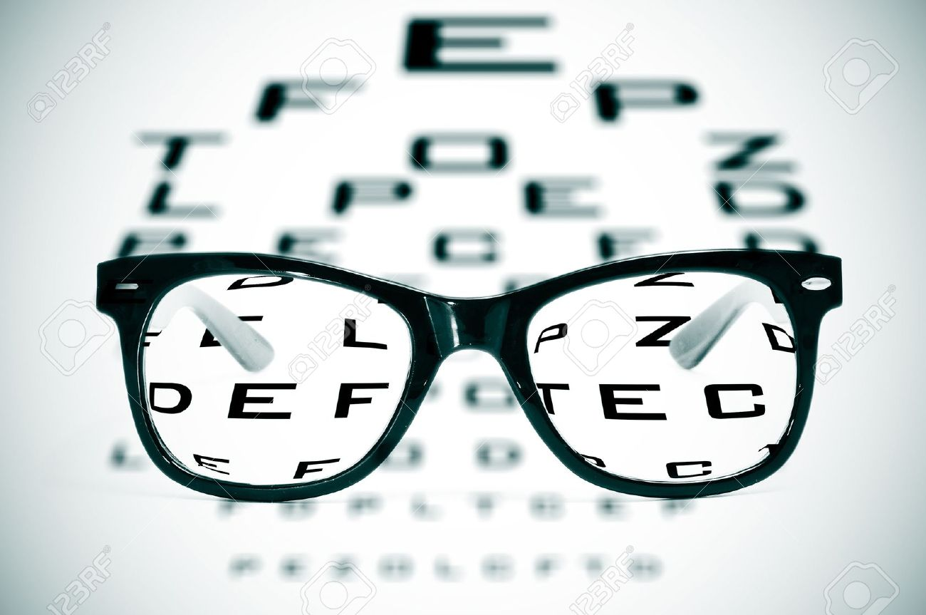 11325859 eyeglasses over a blurry eye chart Stock Photo glasses
